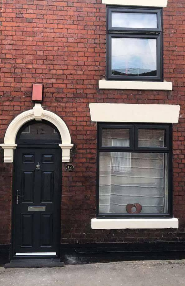 BLACK COMPOSITE DOOR WITH ARCHED TOP AND WINDOWS