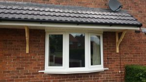 CANOPY AND WHITE BAY WINDOW INSTALLED