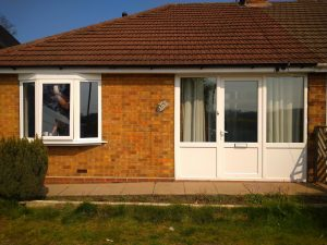 FRONT OF BUNGALOW WHITE UPVC BAY WINDOW AND PORCH