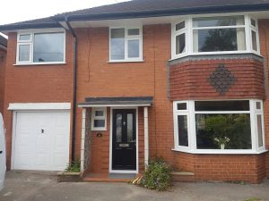 FRONT OF HOUSE WHITE WINDOW BAYS AND COMPOSITE DOOR