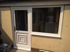 UPVC GARAGE DOOR AND SIDE WINDOW INSTALLED