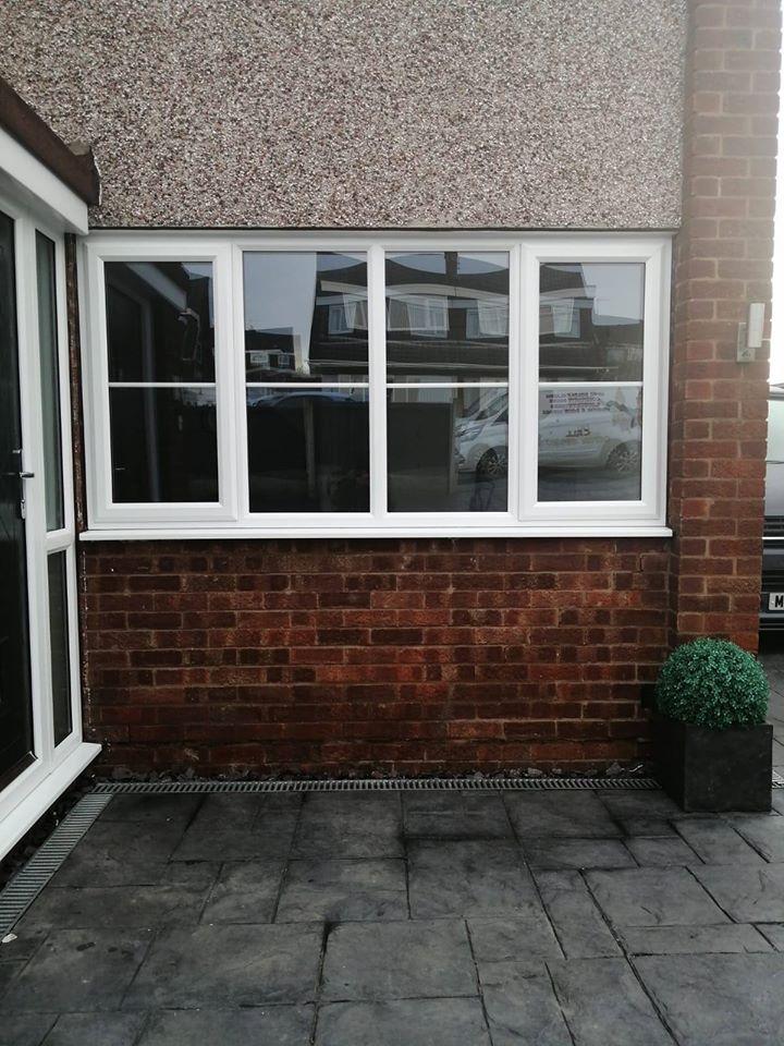 WHITE UPVC WINDOW WITH GEORGIAN BAR